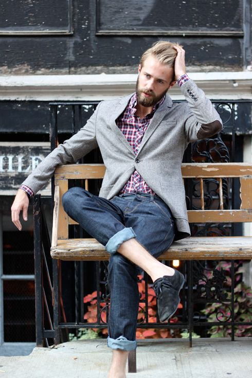 Tom Bull—grey blazer with elbow patch, checkered shirt, and folded up jeans.