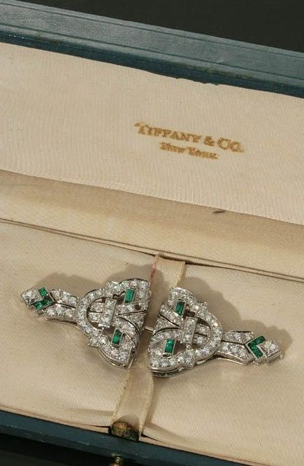 Pair of Art Deco Platinum, Diamond and Emerald Brooch Clips, Tiffany & Co. Circa 1930s. The breakaway mount set with a pavé of eighty-six full-cut diamonds weighing approximately 2 carats, and twelve calibré-cut emeralds. #Tiffany #ArtDeco #brooch #clip
