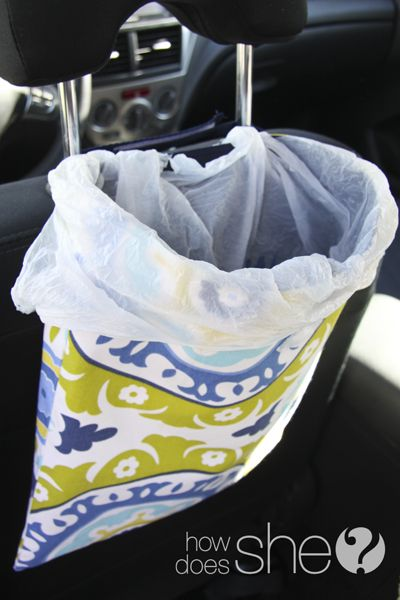 Car Trash Bag - thread the handles of a plastic grocery bag over the 2 straps then tie it in a knot behind the bag. It keeps it from falling down inside and it's easy to take out the trash! You can even stuff a few extra bags in the bottom for replacing.
