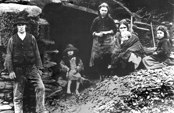 Eviction scene: The descendants of the family in this photograph, taken in Glenbeigh, Co. Cork in 1888, may have survived the Great Famine, but one wonders what became of them following their eviction and demolition of their home. From the Sean Sexton Collection. http://irishamerica.com/2013/08/the-great-hunger-and-the-celitc-gene/