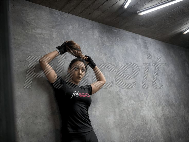 Woman Wearing Custom Sportswear Mockup and Boxfit Hand Gloves While Against a Concrete Wall a16841Foreground Image