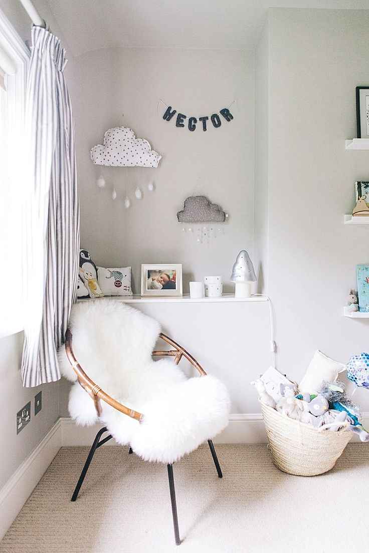 Photography By Adam Crohill - A Modern Stylish Unisex Baby Nursery With A Neutral Grey Colour Scheme With Blue And Green Accents And A Grey Cot From Marks And Spencer And Grey Striped Curtains From John Lewis And Ribba Shelves From Ikea. http://rockmystyle.co.uk/hectors-nursery