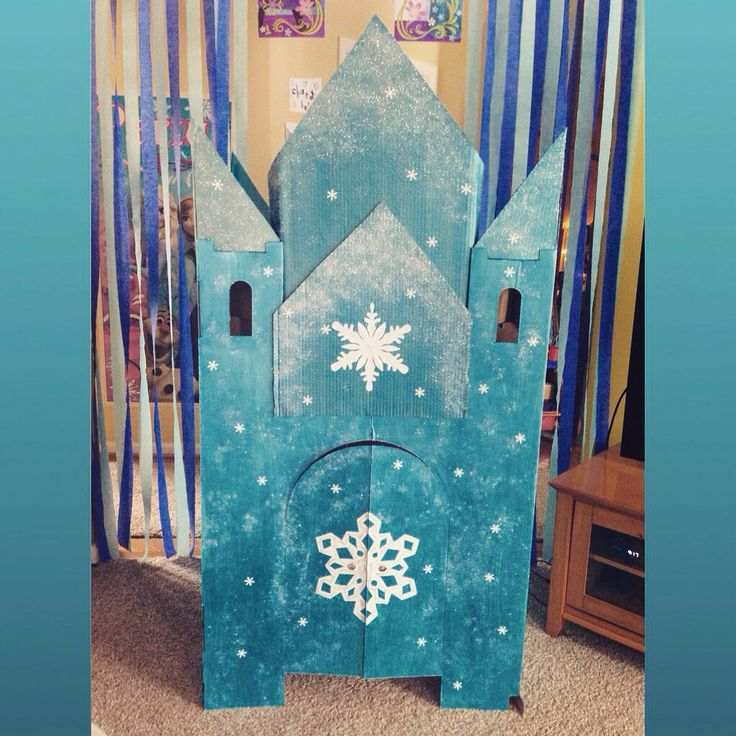 This was a fun Frozen party project for me and my daughters! A homemade Elsa's Castle out of cardboard, metallic paint, glitter, and a little imagination! It looks ice-tastic!
