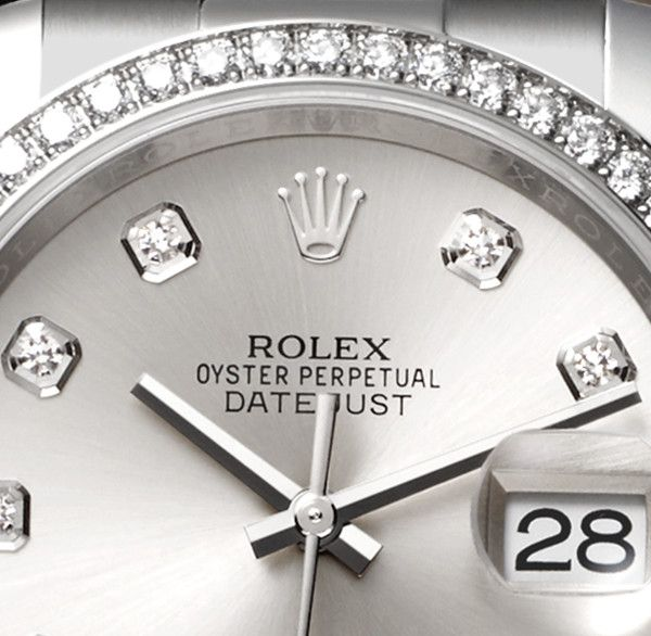 The Rolex Datejust 36 Rolesor with a silver dial, diamond hour markers, a diamond-set bezel and an Oyster bracelet.
