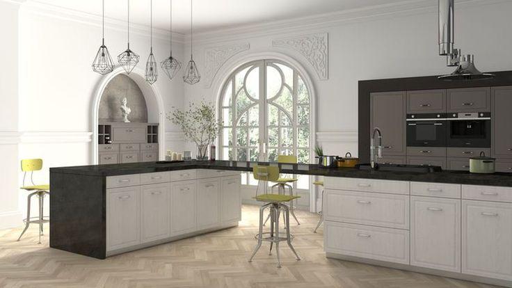 Prostota, która tkwi w białych frontach doskonale wpasuje się do eklektycznej kuchni. Ściany z dekoracjami w stylu klasycyzującym, wyraziste, industrialne lampy i nowoczesny sprzęt AGD, tworzą niepowtarzalną i oryginalną aranżację.