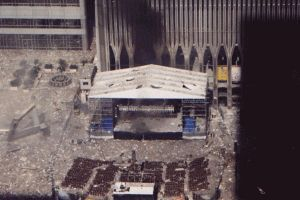 *9/11 WTC AWNING~On the south side, firefighters reported 30-40 bodies on the roof of the 22 flr. Marriott Hotel, adjacent to the north tower.On the west side where the big bronze globe was located, bodies + body parts littered the plaza.