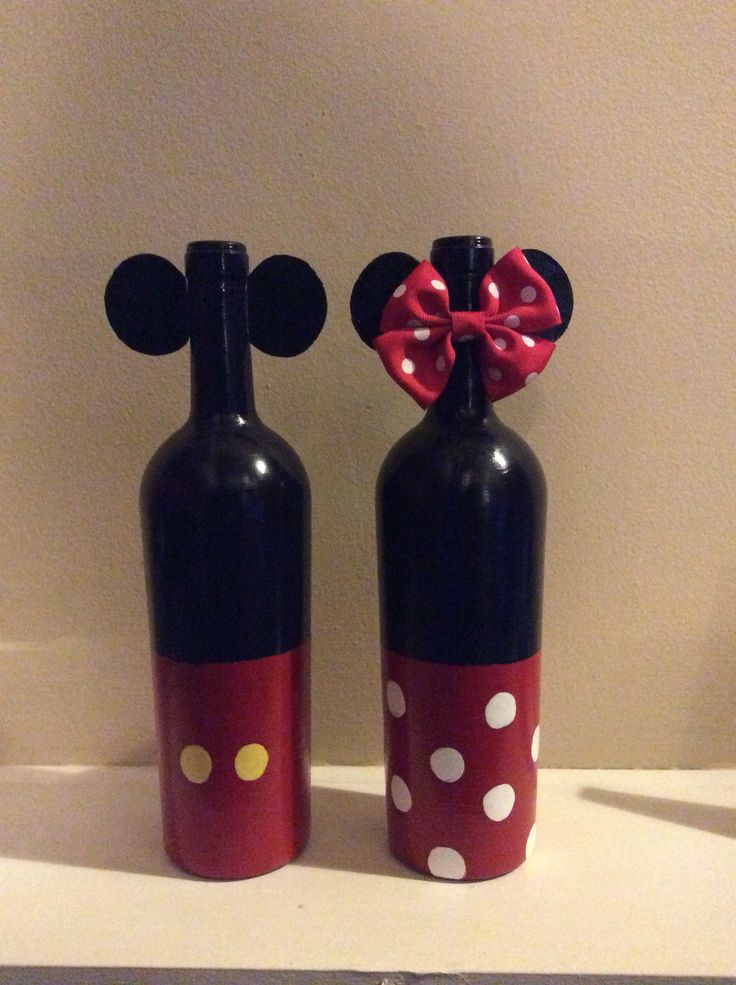 My painted Mickey and Minnie Mouse wine bottles. Hand painted with Acrylic paint. Then finished with a gloss mode podge. The ears are made out of Styrofoam plates, hot glued on. Sold this set for $30