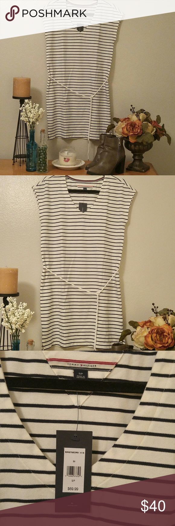 """NWT Tommy Hilfiger Striped V-Neck Tunic Dress Cool and casual, off white and navy blue striped tunic dress by Tommy Hilfiger.   V-neck, capped sleeves, with a rope belt. 35"""" long from shoulder to hem, 17.5"""" bust when laid flat. Tommy Hilfiger Dresses Mini"""