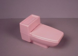 i had this and remember it vividly. pink barbie toilet... fill it with water and open/close the lid and it bubbled at the bottom.