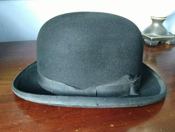 Vintage Edwardian Period Gentlemans Bowler Hat By H. A . Dunn & Co Ltd Piccadilly Circus & 373,4,5 Strand London England Circa 1930  A nice old vintage black bowler hat of small size approximate 6 5/8 Dont miss out on this superb piece of British history making a wonderful collectors item.