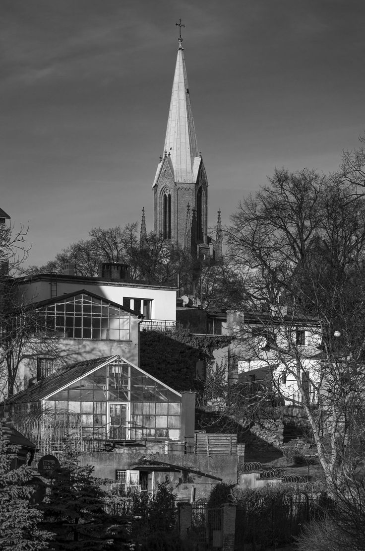Saint Nicolas tower - Saint Nicholas church tower behind buildings covering hill side