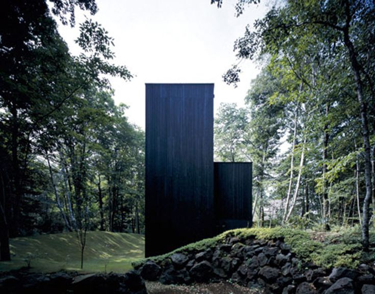 Satoshi Okada's forest retreat in the foothills of Mount Fuji, Japan is one that intentionally is intended as the shadow itself, set against its incredible natural surroundings. Completed in 2000 and covering just over 138sqm, the Mount Fuji House was designed as a secondary element to the site. This opposes, in quite an impactful and stunning way, that the architects have exercised overt sensitivity to the complexity of the buildings' context.