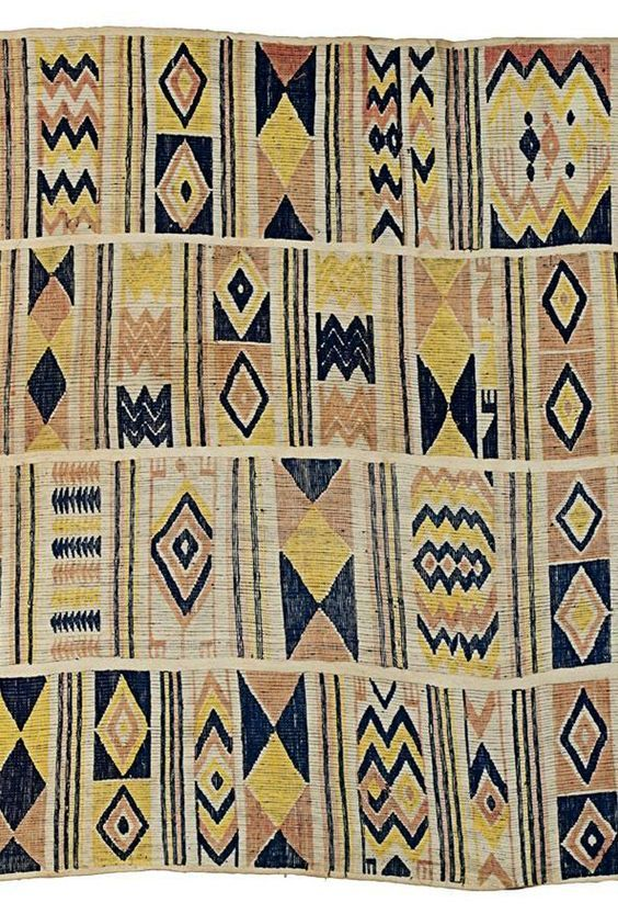 Africa | Detail from an Oshugbo or Ogboni society cloth from the Ijebu Yoruba people of south western Nigeria | Cotton/Silk; woven in four strips with geometric patterns in pink, yellow and indigo || Partial view: