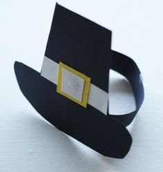 How to make pilgrim hats and bonnets. Draw top of hat in a rectangle, draw belt buckle in a circle, bottom of hat in a rectangle, band as shown....to work on cutting out simple shapes.