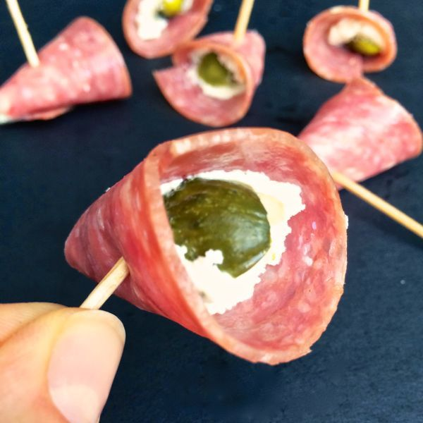 A quick and easy snack or appetizer, these salty, savory, creamy bites of salami, herbed goat cheese and dill pickle are a big crowd pleaser.