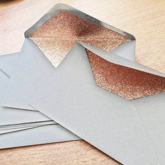 Luxurious and refined, these Dove Grey and Rose Gold glitter lined envelopes; these are a fantastic way to set the tone of your Wedding. Theyll be the first thing your guests see when they open your invitations, so if you want to add some sultry refinement, with a glamorous centre, which leaves a lasting impression and sets the tone of your big day then these are most certainly for you.  There are several gold glitter liners available - and many other colours to boot! Let me know if you…