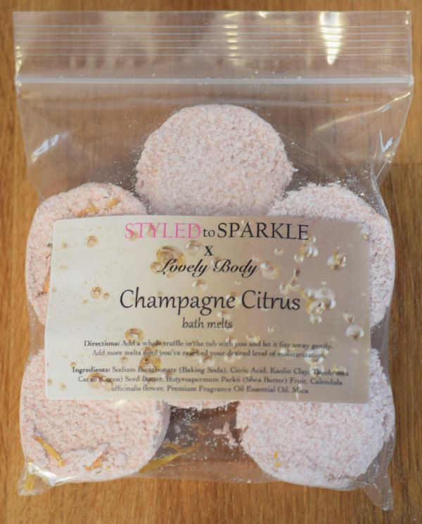 Champagne Citrus Bath Melts - $12.00  Relax in a bath full of tiny bubbles – just like the ones in a champagne glass!  These amazingly moisturizing melts are all natural and feature a zing of citrus combined with champagne for a luxurious bath.  They're also organic and all-natural!