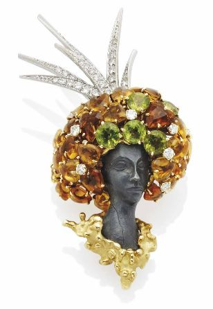 brooch by Pierre Sterlé, 1960 - peridot, citrine, diamonds and carved hematite