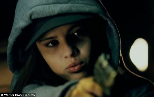 Don't mess with her: Selena Gomez can be seen wielding a gun in the first trailer for her new movie The Getaway