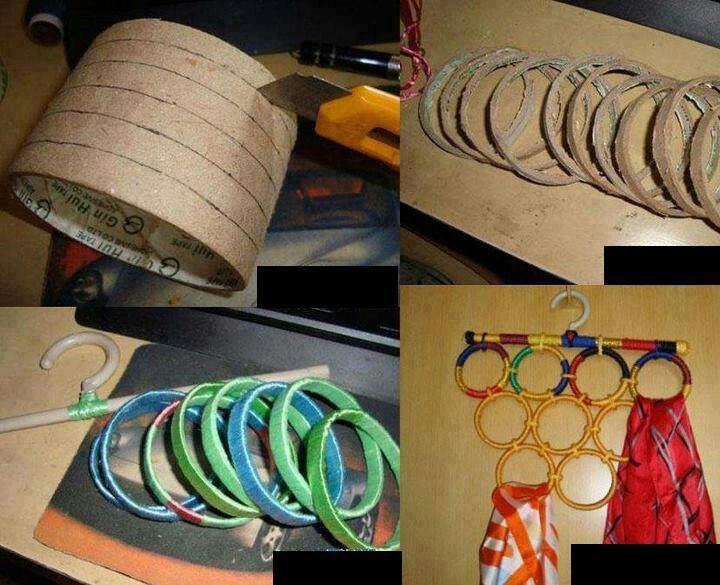 DIY Scarf Hanger made of rings of a cardboard tube all tied together and hung on the wall