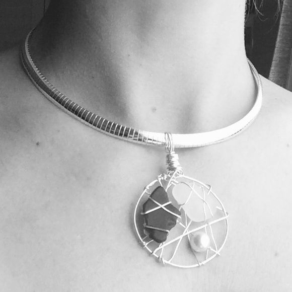 Gorgeous Silver Choker Necklace Gorgeous Silver Choker Necklace. Two stones and a pearl inside. New. Never worn. Jewelry Necklaces