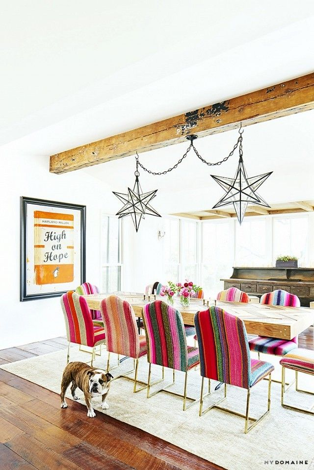 """Decker collected vintage Mexican serape blankets on Etsy to reupholster the full dining room chair set. The bright colors bring just the right amount of fun into the dining room. """"It's a margarita pink. Everyone loves a margarita pink!"""" she says."""