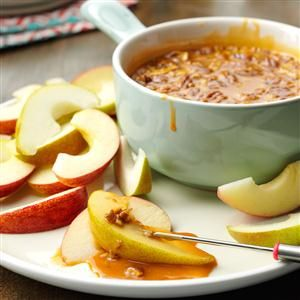 Butterscotch Fruit Dip Recipe -If you like the sweetness of butterscotch chips, you'll enjoy this warm rum-flavored fruit dip. I serve it with apple and pear wedges. It holds up for up to two hours in the slow cooker. —Jeaune Hadl Van Meter, Lexington, Kentucky