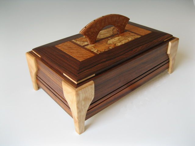 Personalized keepsake box made of wood with decorative handle on lid