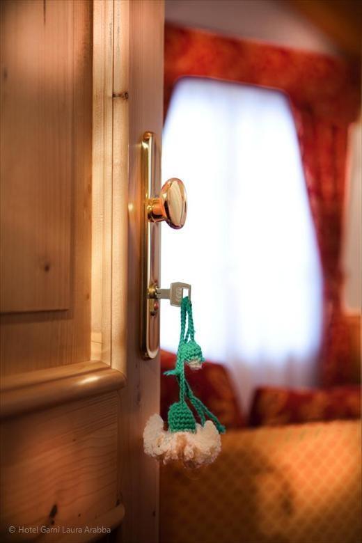 The room entrance with a special handmade keychain. Hotel Garnì Laura Arabba
