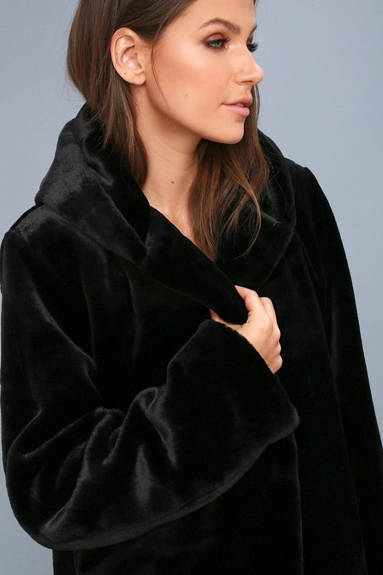 The Faire Black Faux Fur Hooded Jacket makes any look effortlessly chic! Ultra soft and luxe faux fur shapes an oversized hood, and relaxed long sleeves. Open front design.