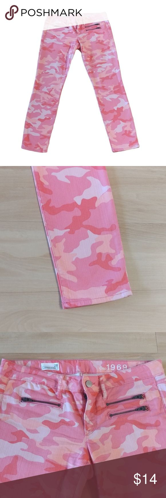 """GAP Jeans Womens Camouflage Skinny Leg Step up your denim style with GAP's camouflage ankle skinny jeans!  Size:28 Color:Pink/Orange (Peach) Style Type:Skinny Leg Care:Machine Washable Fabric:98% Cotton 2% Spandex Measurements:Inseam: 28""""; Front Rise 8""""; Waist 32""""; Hips 36"""" More Information:Front button and zip closure; belt loops. 3 front zip closure pockets & 2 slip pockets. Allover camouflage print. In great condition with no stains or tears noted! Very gently worn! GAP Jeans Skinny"""