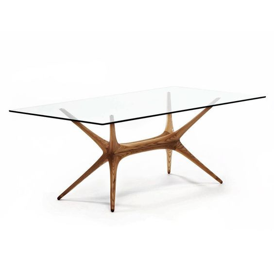 This stunning wooden and glass X-frame table was created by the Finnish designer Tapio Wirkkala in 1958. It is still available through Artek today.