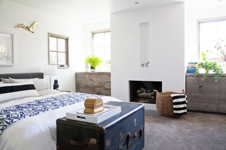 You'll Envy This Effortlessly Cool Family Home // Stripe throw pillow, white lacquer tray, trunk end table: Rustic Dressers, Modern Fireplaces, Modern Farmhouse, Old Trunks, Reclaimed Wood, Built In Dressers, Master Bedrooms, Studios Cities, Inspiration Bedrooms
