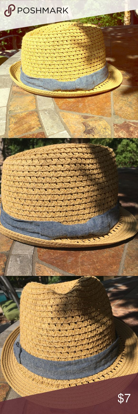 Tan Straw Fedora Hat Lightweight tan Straw fedora hate with chambray Rubino around it. Ribbon has a bow on one side. Great hat that matches with everything! Target Accessories Hats