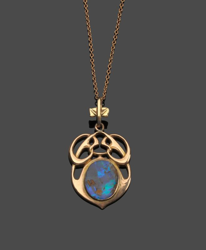 Archibald Knox gold and black opal pendant