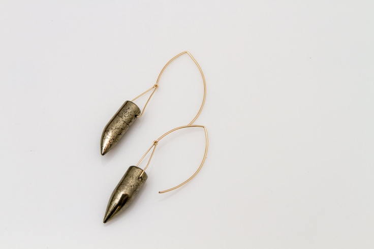 Presley Earrings - Named after the King, these rockin' earrings are made from a glossy polished pyrite - or fools gold as you probably know it - but you will look the furthest thing from a fool when you wear them.  Also known as our 'bullet earrings,' the Presley Earrings will soon become a part of your daily fashion arsenal. They are gorgeous and streamlined but also just plain bad-ass.