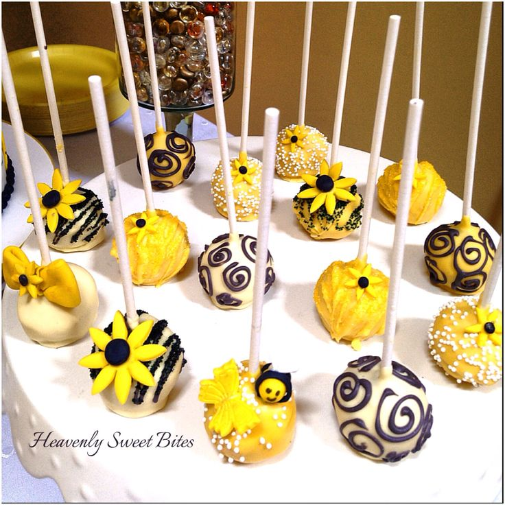 Bumble Bee Dessert Table by Heavenly Sweet Bitesin New Jersey. Honey lemon cupcakes, cake pops, bee cake pops, vanilla& chocolate pudding with berries, marshmallows, cake with berries and cream cheese frosting.
