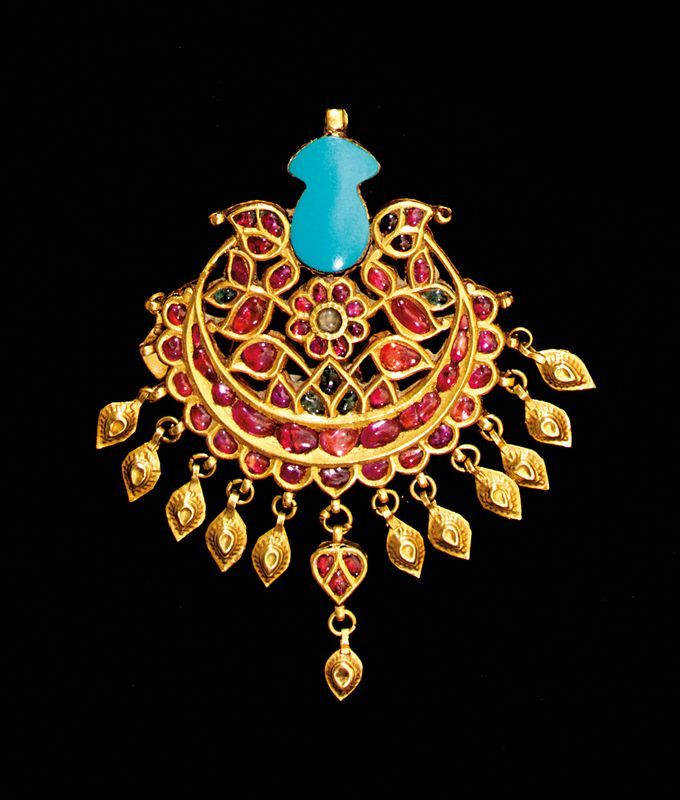 A 19th/20th century Mughal Indian gold (24k)  and semi-precious stone pendant.