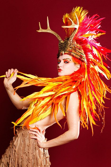 FIERY STAG.... Antler Headdress with Huge Feather Mohawk and Feather Train.