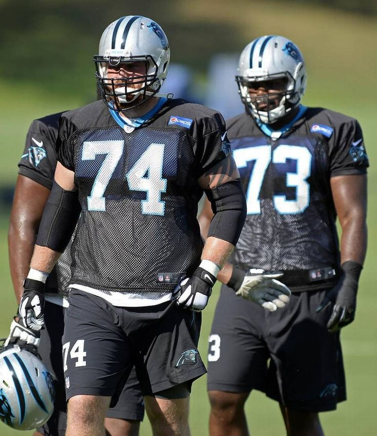 Carolina Panthers' Mike Remmers (74) and Michael Oher (73) prepare to drill during morning practice at Carolina Panthers Training Camp at Wofford College in Spartanburg, SC on Wednesday, August 12, 2015.