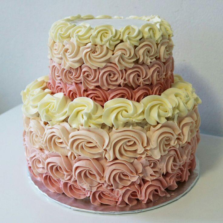 2 tiered vanilla ombre rosette cake with swiss meringue bhttercream