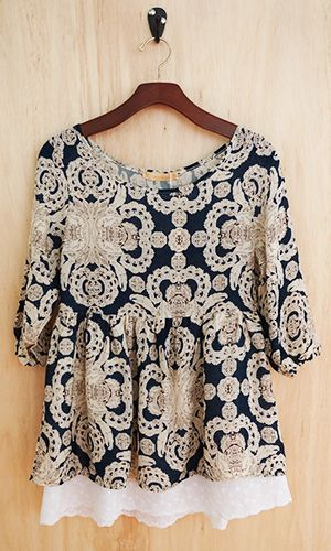 This top is really cute.  Something like it with a different color background maybe?