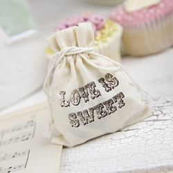 Wedding handouts. Little baggies with candy inside. Maybe instead of saying Love is Sweet, have it say the names of the couple and the wedding date. :)