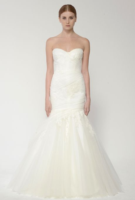 Brides: Bliss by Monique Lhuillier. Silk white Chantilly and re-embroidered lace strapless sweetheart neckline trumpet gown with tulle skirt.