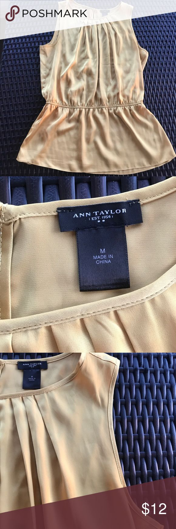 Ann Taylor gold sleeveless blouse 95% Polyester, 5% Spandex with elastic waist!  Great for layering with a fall jackets.  Sight pull on front and lols Ike a loose string as depicted on image 4 Ann Taylor Tops Blouses