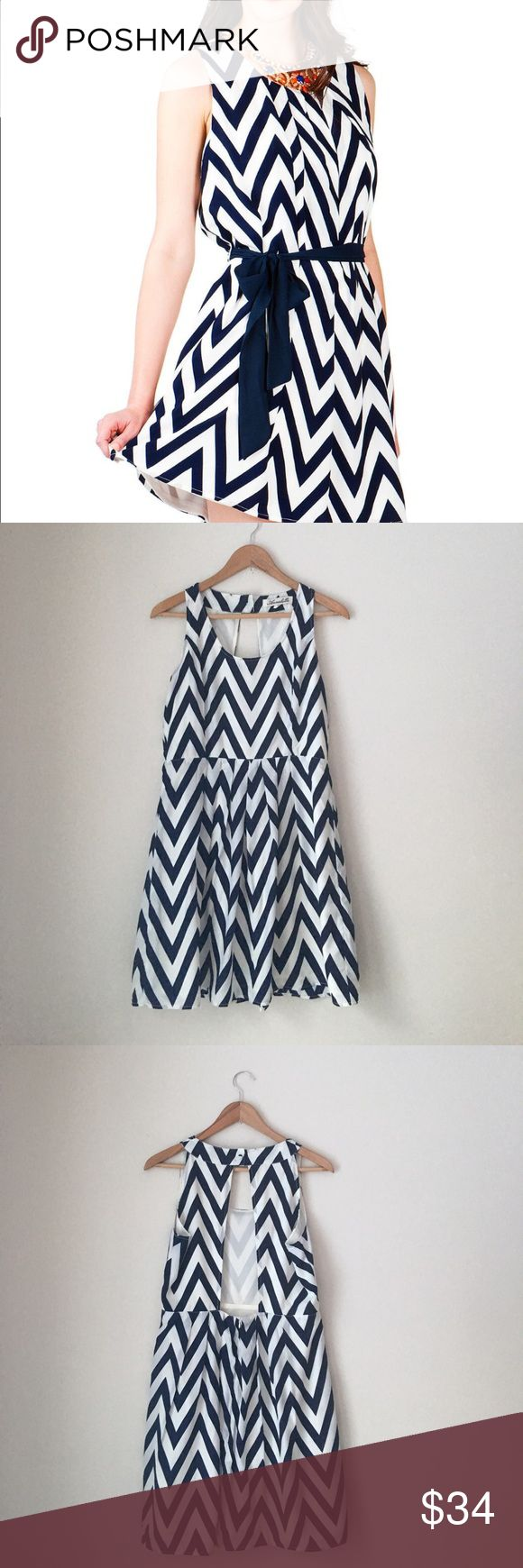 Francesca's Annabella Navy Chevron Dress Navy chevron dress by Francesca's Annabella. (Model is wearing slightly different style – this dress does not come with a sash ). Crewneck. Sleeveless. Open back. Size large. Like new. Francesca's Collections Dresses