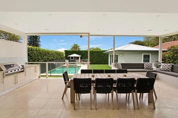 Outdoor bbq/kitchen + covered verandah + bench seating + pool. Domain.com.au : house in Freshwater.