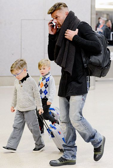 Ricky Martin and twin sons Matteo and Valentino (b.Aug. 2008) arrive at LAX on 5 January 2014.