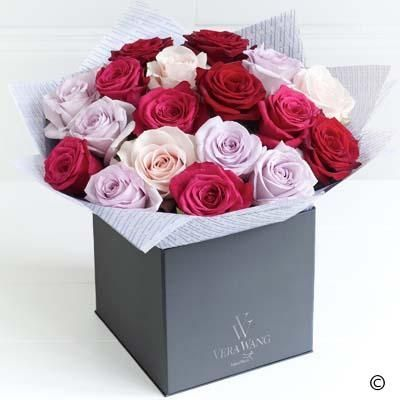 The exceptional beauty of roses is captured perfectly in this sophisticated Vera Wang bouquet. The soft petals of these stunning red roses have the sheen of purest velvet, whilst the palette of pinks and soft lavender offers chic contrast and variation. An exquisite display.
