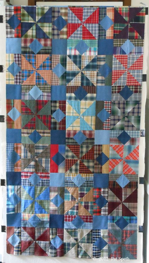 Recycled shirts---8 in. finished pinwheels and 4 x 8 in. sashings.  Pat Speth's design